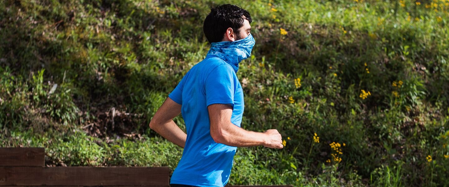 man running with face covering