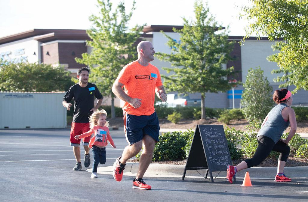 man and child running