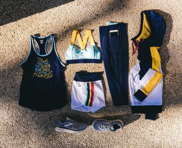 Brooks tank, shirt, sports bra, shoes, jacket on gray background