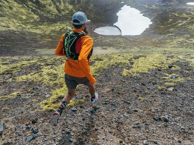 man in hydration vest on trail run
