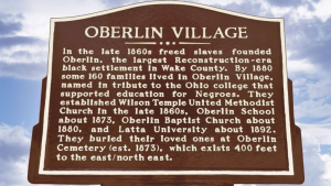 city marker noting the Oberlin Village historic area