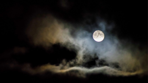 full moon at night with some clouds