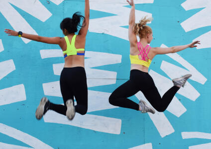 two women jumping