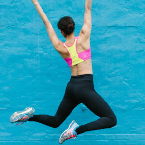 back of woman jumping
