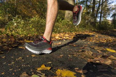 HOKA Bondi 5 red man running in fall