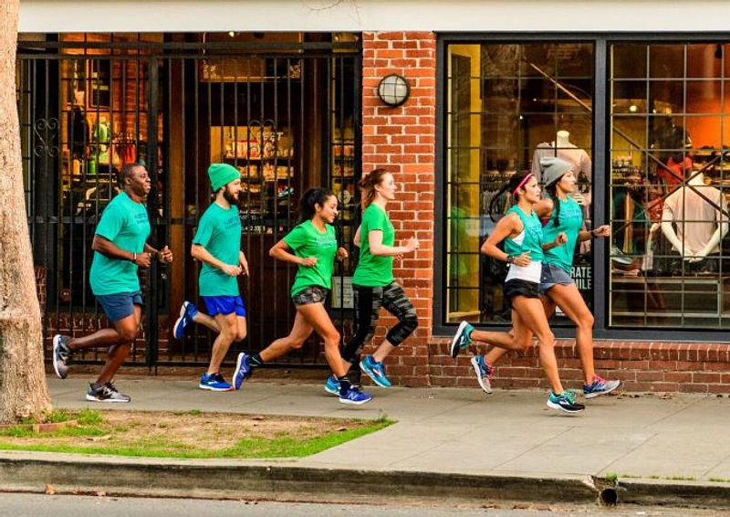 Group of runners going down the sidewalk