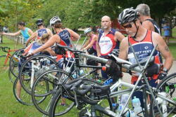 Tri group racking their bikes before the race