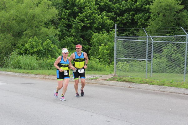 Susan finishing the Foothills Sprint with Shahin