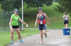 Anne splashing Katlyn at the water stop!