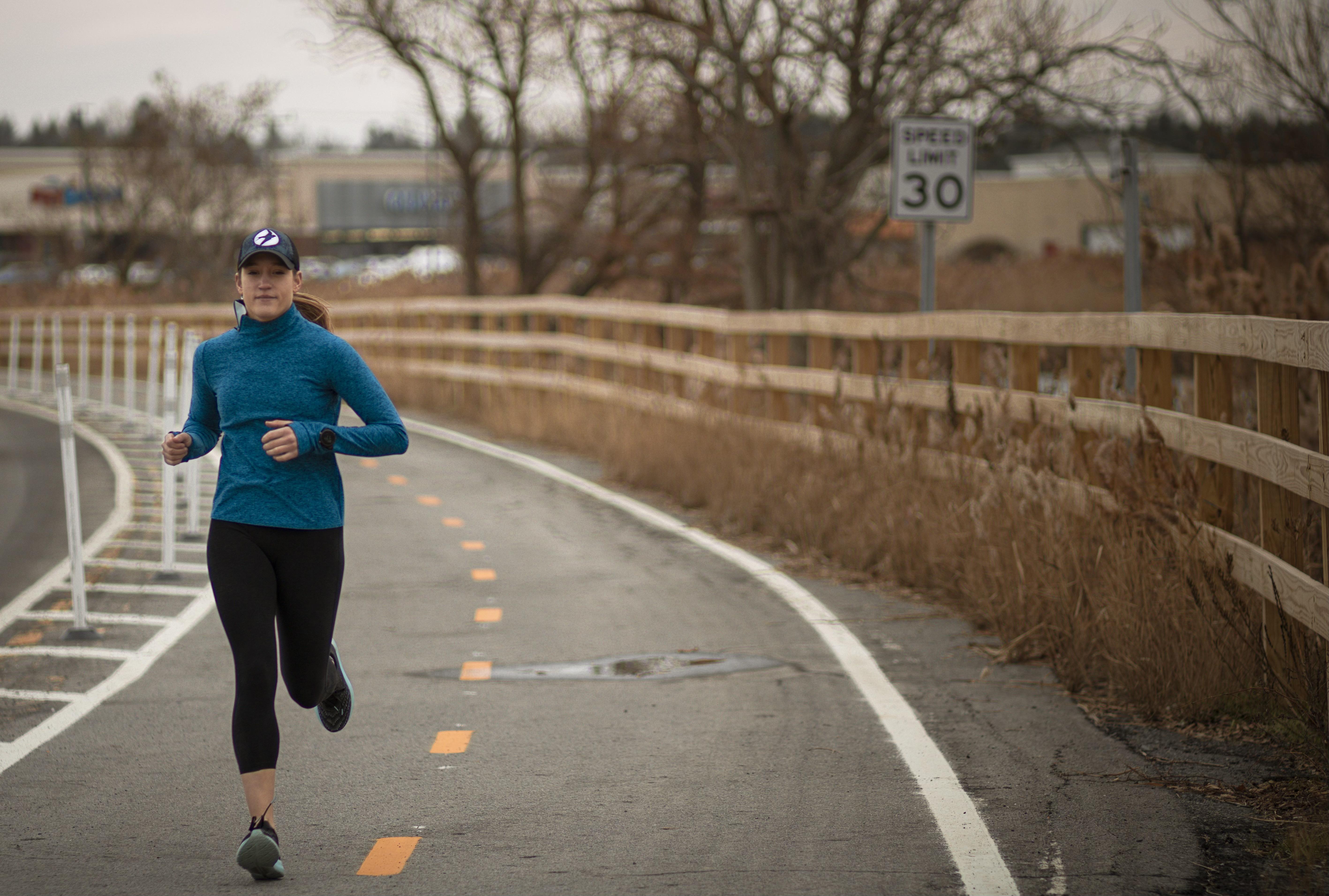 Coach Laura running at Fleet Feet Syracuse