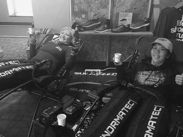 Normatec recover with a friend