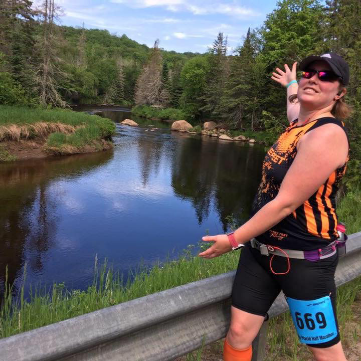 Gretchen on bridge during Lake Placid Half Marathon
