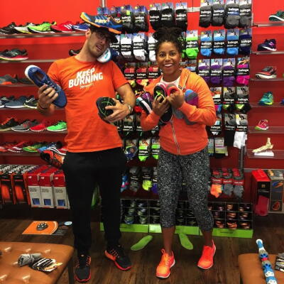 Trainers Parker and Amanda having some fun while shopping at Fleet Feet