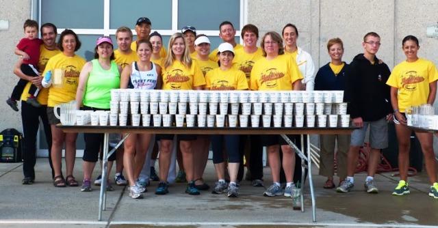 Fleet Feet Madison & Sun Prairie volunteer aid station for the Madison Mini Marathon & 5K
