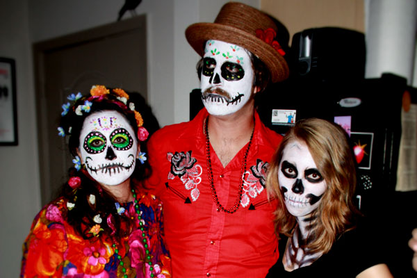 Skeleton and Day of the Dead sugar skull costumes for Halloween party