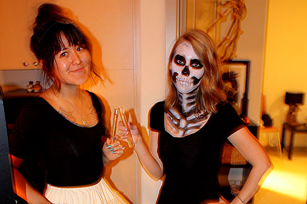 Halloween party skeleton and American Apparel Ballerina. Holding test tube shots