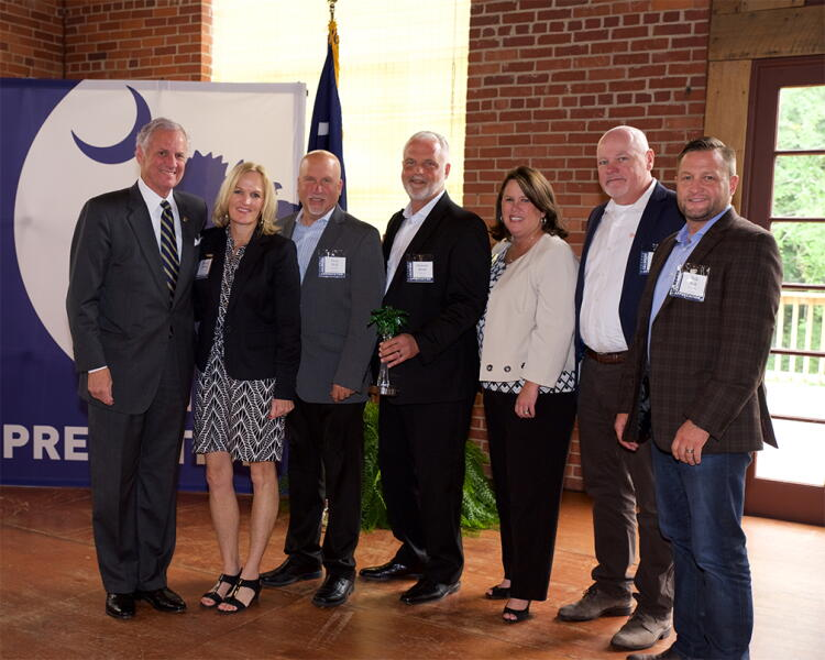 Company leaders from Shutterfly accept an Industry Impact Award. They are joined by Governor Henry McMaster.