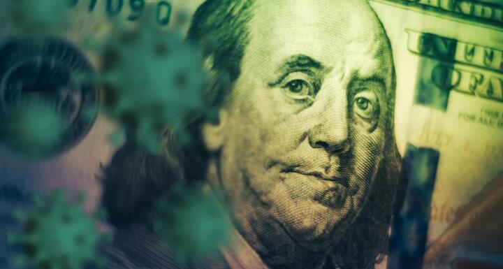artistic shadowed rendering of Benjamin Franklin's face on the hundred dollar bill