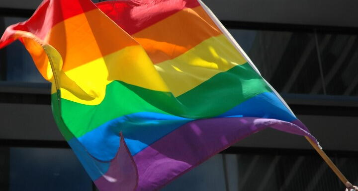 Closeup of a rainbow pride flag waving in the wind