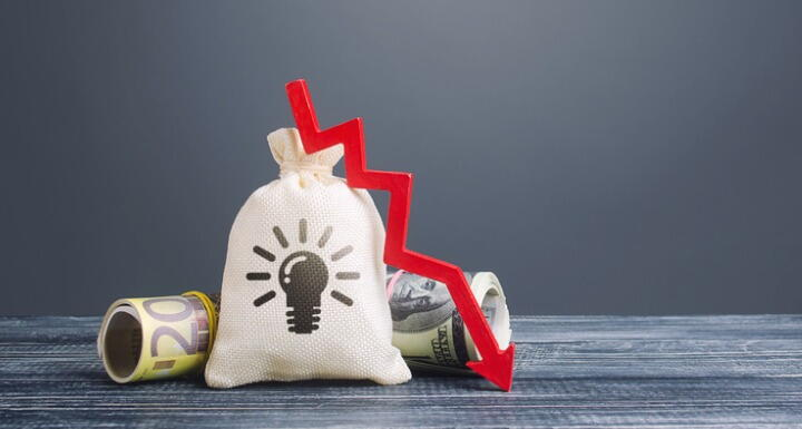 Bag with ideas patents and red down arrow.