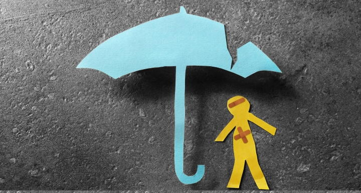 bandaged paper man under cracked umbrella