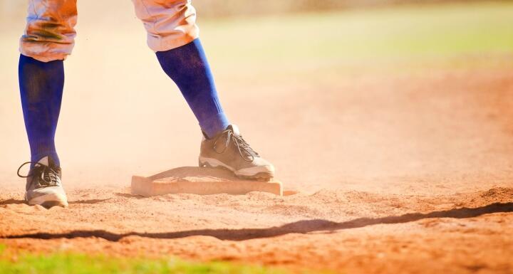 Dirty baseball player on base