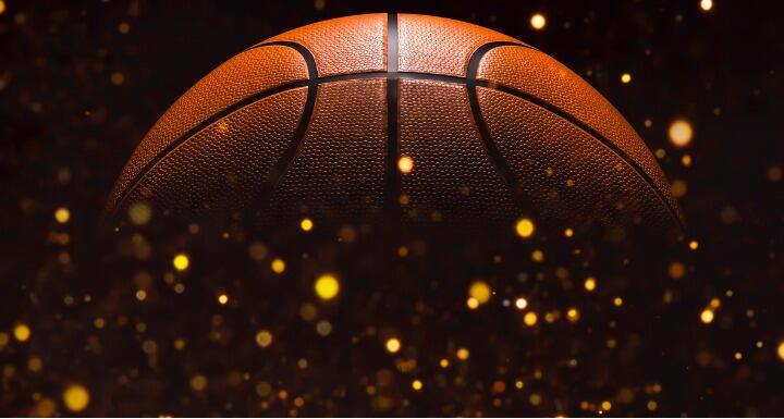 Close up on basketball ball on a black background with glitter