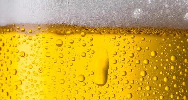 Close up shot of beer glass with dew