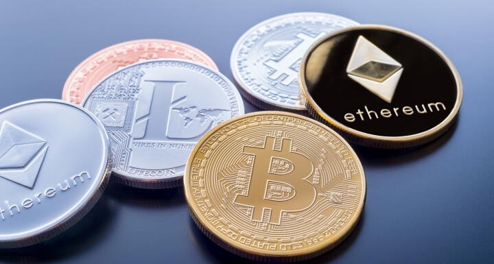 Coins with the logos of Bitcoin and Ethereum stamped on the faces