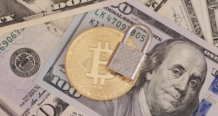 Lock and bitcoin on top of paper money