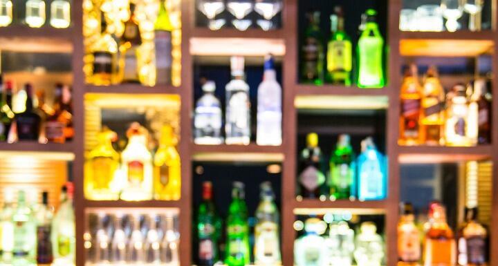Blurred bottles of liquor at a bar