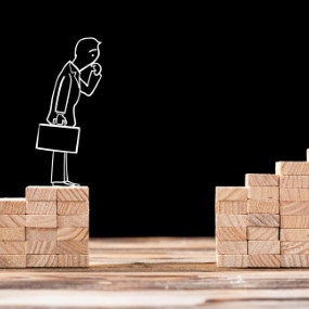 Cartoon chalk man pondering gap between two wooden blocks