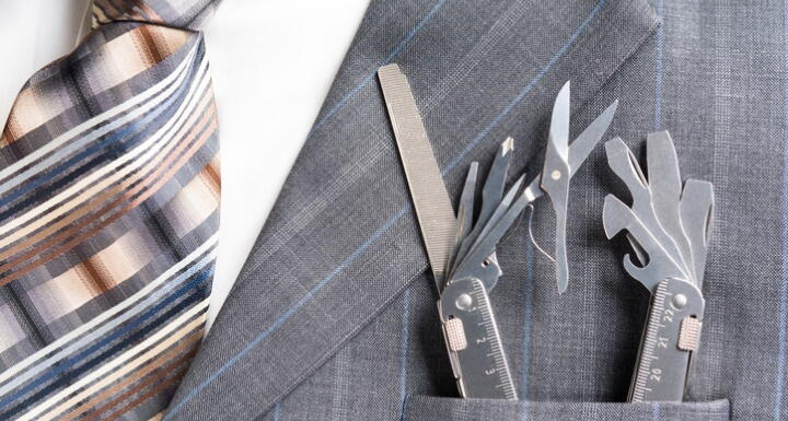 Close up of business man in suit with tools in suit lapel pocket