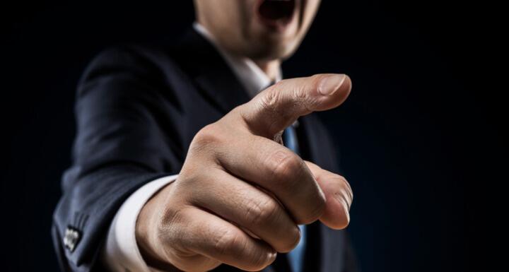 Businessman sticks out a finger