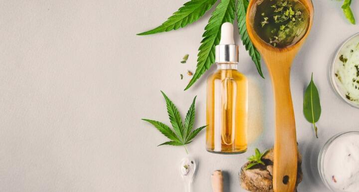 Hemp leaves and bottle of CBD oil