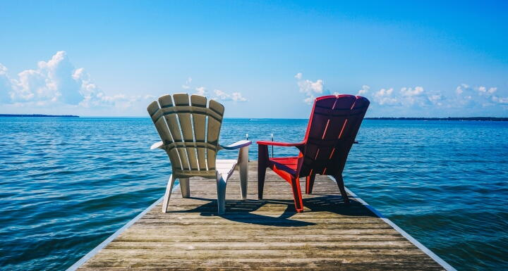 Red and white chairs on dock
