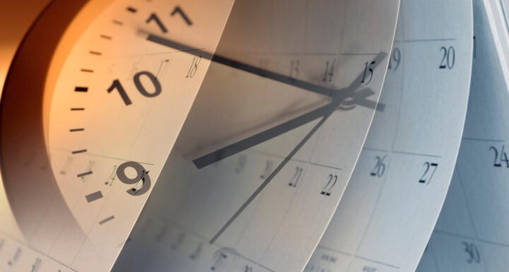 A clock superimposed on calendar months