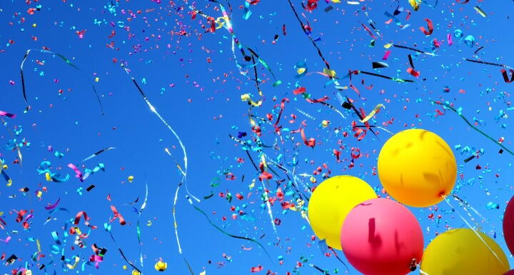 Colorful Balloons and confetti on blue sky