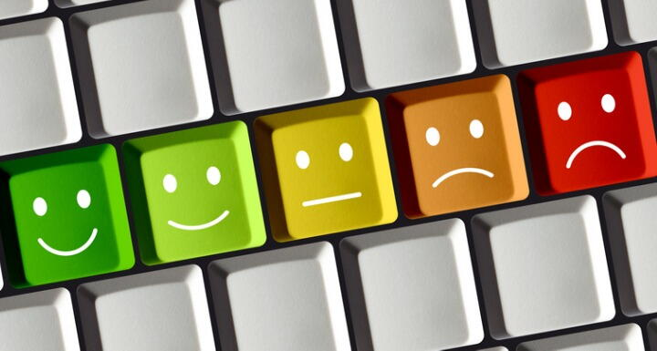 Computer Keyboard with colored keys showing positive and negative emotion from red over yellow to green