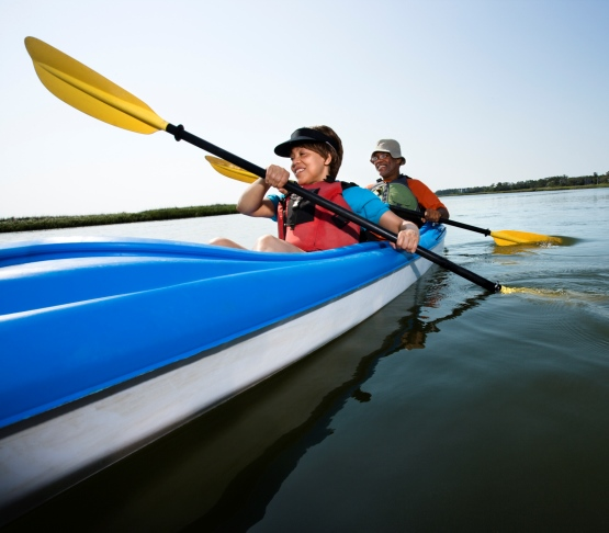 Couple Kayaking on Smooth Waters