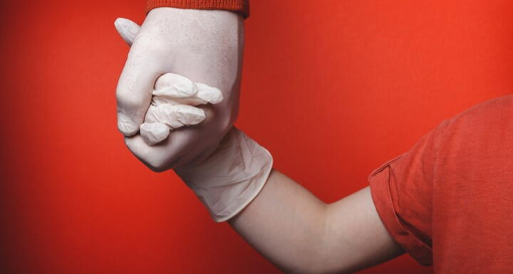Dad and son holding gloved hands
