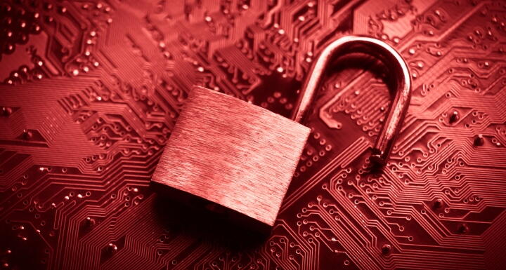 Open lock on top of computer motherboard signifying data breach