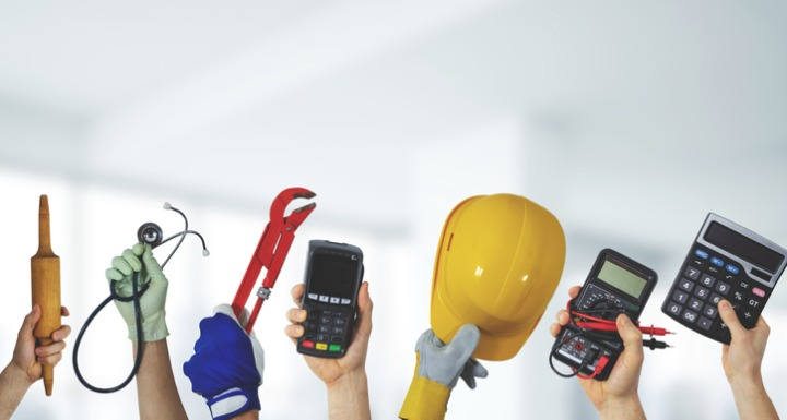Hands holding tools that signify different jobs