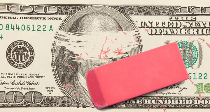 one hundred dollar bill with Ben Franklin's face erased by a pink eraser