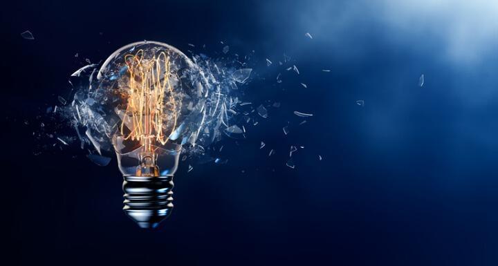 Lightbulb exploding into glass fragments