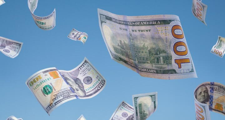 Money falling from blue sky