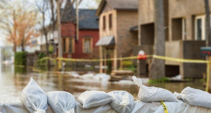 Flooded neighborhood with sandbags