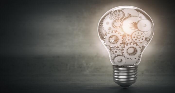 Metal gears inside of a lit lightbulb