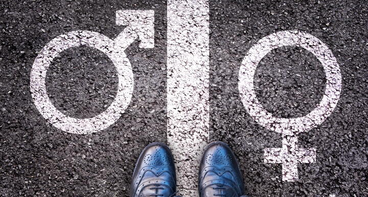 Female gender sign and male gender sign with line down the middle signifying gender divide