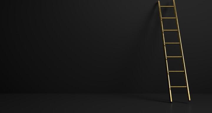 golden stepladder on black background